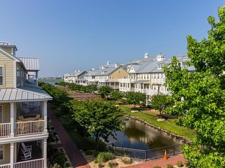 NEW LISTING! Stunning home with canal views, shared pool & sauna, private beach