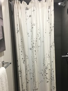 Guest bathroom with shower is located upstairs.