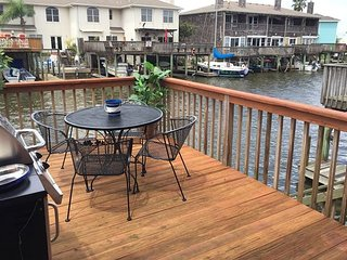 6 Minutes to the Beach! Canal-Front 3BR w/ Elevated Deck & Private Boat Dock