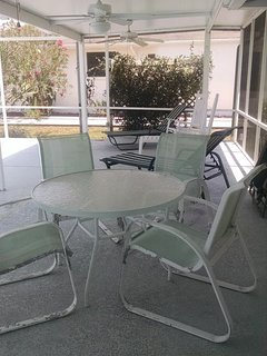 Lanai comes with table with seating for 4, 2 lounge chairs and 2 rocking chairs