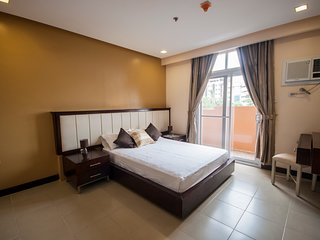 2br Executive Suite near Ayala, free weekly housekeeping, cable, wifi & parking