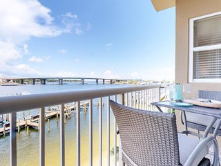 Gorgeous waterfront condo w/ shared pool, hot tub, & 3 balconies