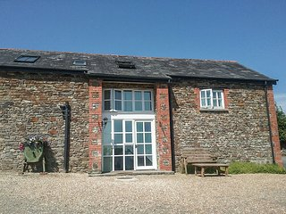 WEST BOWDEN FARM, barn conversion on a sheep farm, all bedrooms with TVs and en-