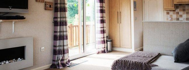 Patio doors lead out the side of the lodge to the hot tub