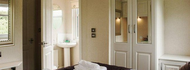 Main bedroom with ensuite toilet and wash basin