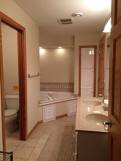 Downstairs shared bathroom with jacuzzi tub & separate toilet & shower