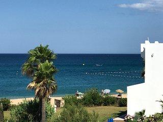 Triplex vue mer pied dans l'eau : parking , wifi, plage , piscine