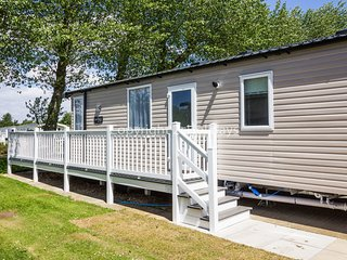 6 berth caravan with D/G + C/H with decking and stunning views. REF 42017