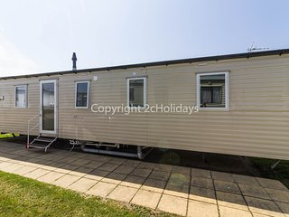 8 berth caravan. At Hopton Holiday Village, pets welcome. Ref 80041