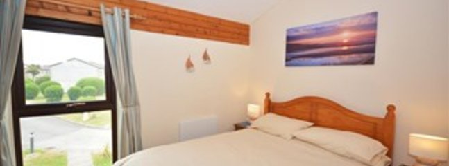 Front Double bedroom looking over holiday village