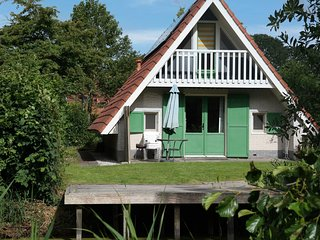 Home Julia w/ Sauna on a typical dutch canal, by National Park Lauwersmeer
