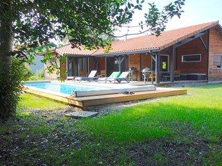 maison bois piscine chauffée océan