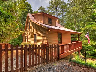 Wood Haven is a pet friendly cabin that sleeps 10 w/ wifi air hockey & fire pit!