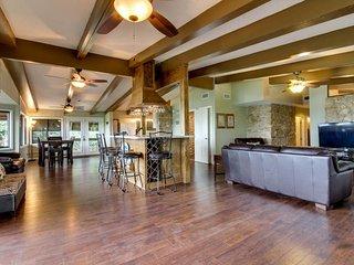 Beautiful, spacious home w/ lake views, private hot tub, & great deck!
