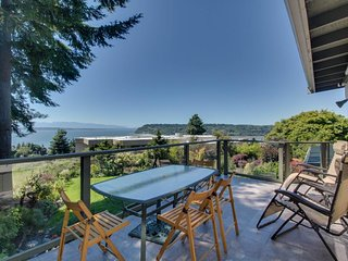 Elegant island home with bay views and gorgeous gardens!