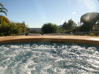 Your very own jacuzzi provides views down to the pool and and distance mountains.
