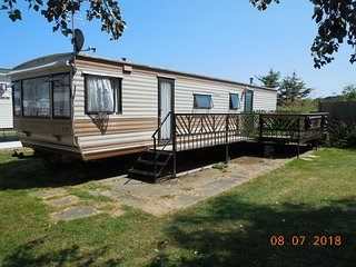 Large 2 bed caravan, secluded plot, separate dining & lounge area. FREE parking