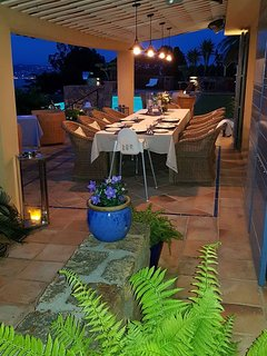 Patio with large dining table for up to 12. Electric heater, fantastic sea view.