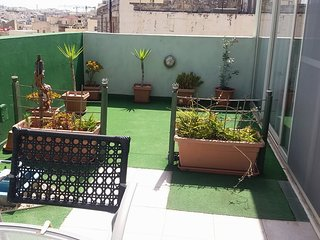Birkirkara penthouse with lovely terrace in the heart of town.