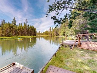 NEW LISTING! Riverfront cabin with a spacious deck by the water, free WiF