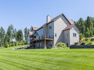 NEW LISTING! Extravagant home w/ deck, lake views -fitness room & pool table