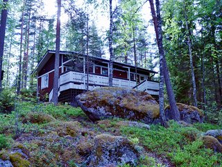 Silent, fantastic cottage by lake, private area, sauna and boat