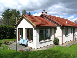 Nethy Bridge holiday home with forest, river and mountains nearby.