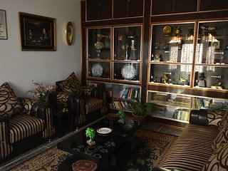 A shared living room neatly arranged souvenirs and sofas, allow space for conversations and bonding.