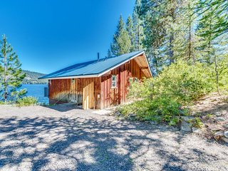 Secluded waterfront home w/ spacious deck, stunning views of lake & mountains