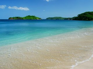 Affordable Resort Seconds to White Sand Beach!