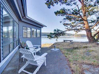 NEW LISTING! Peaceful bayview home w/nautical theme & bridge views
