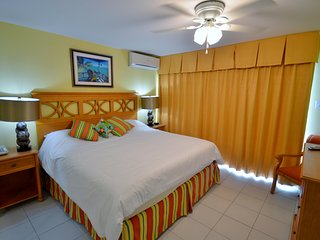 Spacious Condo near Beach w/ WiFi, Resort Pool, Spa & Fitness Room