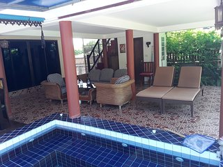 Sitting / relaxing veranda with open sided sala above. You can choose to relax in sun or most welcom