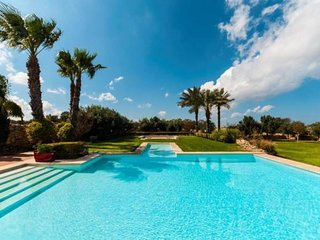 Exclusive Villa with 19,000 square feet of lush gardens and pool.