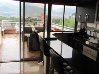 9 Bedroom building including roof and hot tub on deck AC lleras area
