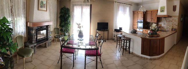 The living room and kitchen, fully equipped