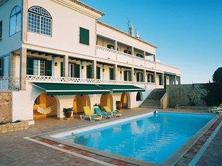 Large villa sleeps 19 right next to the beach!