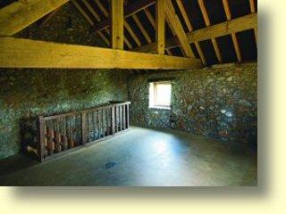 Spacious communal upstairs sleeping area with impressive original internal beams