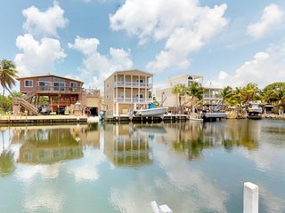 NEW LISTING! Waterfront home with screened-in porch and amazing water views!