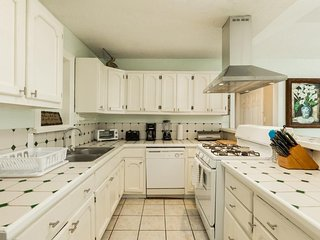 Dog-friendly home with front patio for family gatherings - walk to the Seawall
