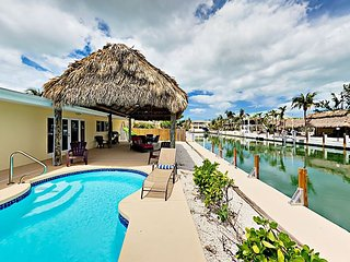 Canal-Front 3BR w/ Private Pool, Boat Slip, Tiki Hut & Kayaks - Near Beach