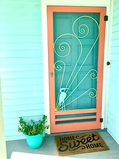 Home Sweet Home! Walk through the vintage screen door into the happy beach cottage.