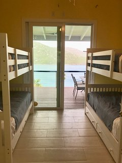 The bunk room is located in the main building. Sleeps four. Full bath just across the hall. :-)