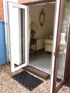 French doors leading out from living room to garden.