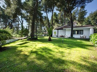 Villa Emily in Sani with garden and pool, by JJ Hospitality