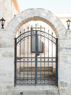 The front gate is wrought iron