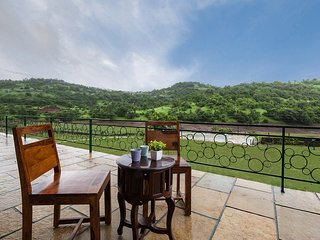 Outdoor seating with hill view