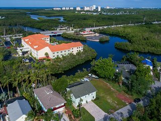 Tropical 'Key West' style waterfront paradise with views/pool/spa & boat dock!