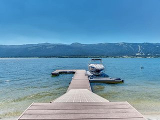 NEW LISTING! Spacious lakefront home w/private docks, beach, modern perks