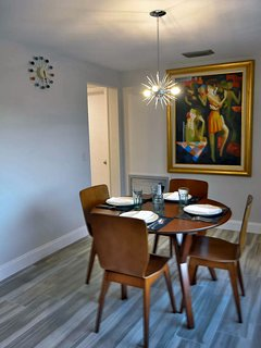 Dining Area Facing SE--Featuring George Nelson Ball Clock, MCM Oil Painting, Sputnik Light Fixture.